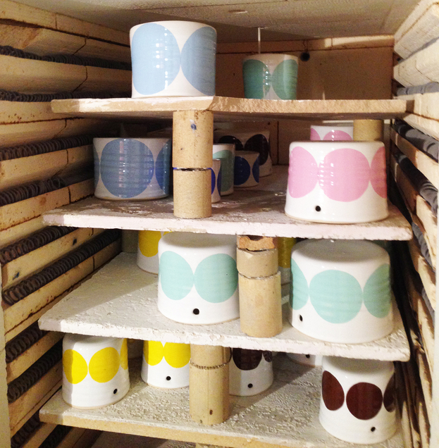 Pots in the kiln. This is their third birning, with their decals attached.