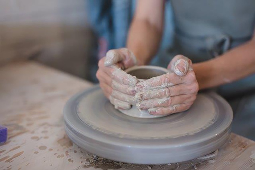 Lots of water is needed to keep the clay smooth during the throwing process.